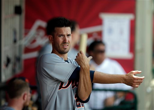 . Detroit Tigers starting pitcher Rick Porcello stretches in the dugout during the sixth inning of a baseball game against the Los Angeles Angels on Sunday, July 27, 2014, in Anaheim, Calif. (AP Photo/Jae C. Hong)