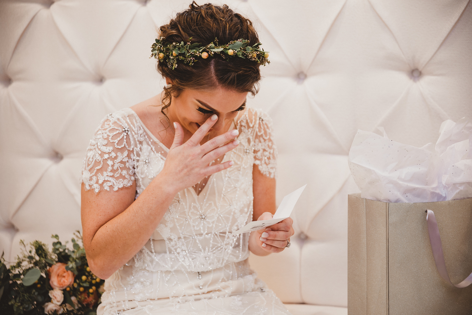 A bride reading a special note and tearing up