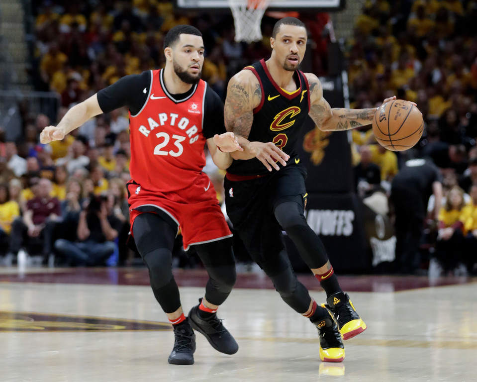 . Cleveland Cavaliers\' George Hill (3) drives on Toronto Raptors\' Fred VanVleet (23) in the first half of Game 4 of an NBA basketball second-round playoff series, Monday, May 7, 2018, in Cleveland. (AP Photo/Tony Dejak)