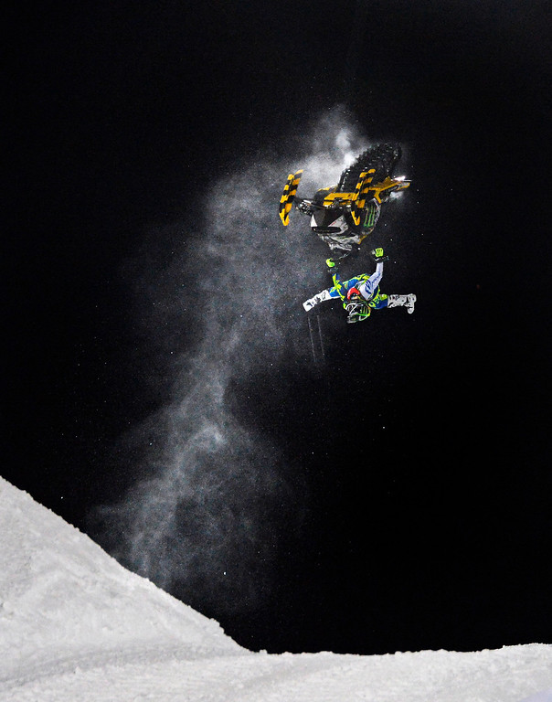 . Heath Frisby flies high during the Snowmobile Freestyle Finals at the Winter X Games in Aspen, January, 23 2014. A year ago, during this event Caleb Moore crashed and a week later passed away due to his injuries. (Photo by RJ Sangosti/The Denver Post)