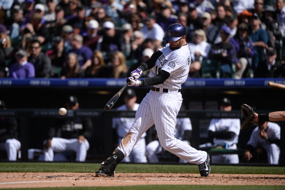 . Charlie Blackmon hits a single to right field during the third inning. The Colorado Rockies hosted the Arizona Diamondbacks in the Rockies season home opener at Coors Field in Denver, Colorado Friday, April 4, 2014. (Photo by Karl Gehring/The Denver Post)