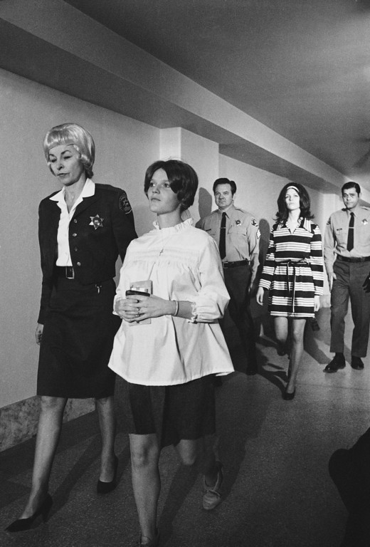 . Mrs. Linda Kasabian, front center, accused along with Charles Manson and others with the murder of actress Sharon Tate and others, arrives in court, Feb. 9, 1970, Los Angeles, Calif. Her attorney pointed out she is expecting a child about April 1, but the judge said he would put off consideration of a trial date change until later. At right is another defendant, Leslie Van Houten. (AP Photo/Wally Fong)