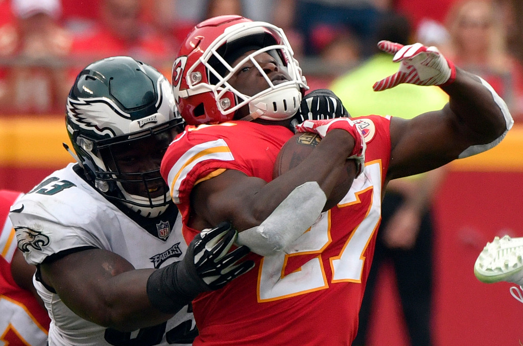 . Kansas City Chiefs running back Kareem Hunt (27) is tackled by Philadelphia Eagles defensive tackle Tim Jernigan (93) during the second half of an NFL football game in Kansas City, Mo., Sunday, Sept. 17, 2017. (AP Photo/Ed Zurga)