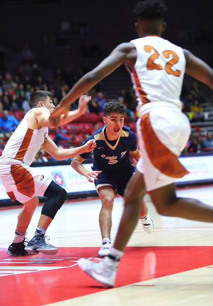 The Santa Fe High School Demon team faces off against Eldorado. The  Demons beat the Eagles 64-56 in the Quarterfinals at the DreamStyle Stadium on March 13 , 2019. Gabriela Campos/The New Mexican