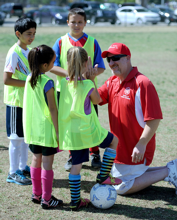 ". Hershey Weisman talks with children before they play in a game. In honor of the AYSO\'s 50th anniversary as the nation�s most active and open youth soccer organization, kids at Balboa Park in Encino will join efforts around the country Saturday--over 500,000 players,125,000 volunteers,100 community-based events and a national soccer festival--to set a world record for the ""largest pickup game on Earth.\"" Encino, CA. 5/3/2014(Photo by John McCoy / Los Angeles Daily News)"