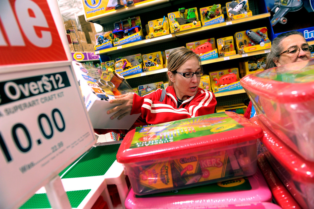 . Anne Whipple, center, and her mother Donna Kolosky, right, searched for the right items at the Toys R Us store on County Line Road in Arapahoe County Thursday night, November 28, 2013. The store opened at 5 p.m.Many metro area stores got a jump on Black Friday sales by opening Thanksgiving night. Photo By Karl Gehring/The Denver Post