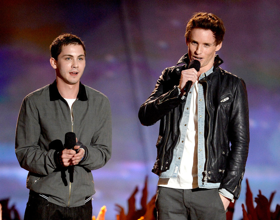 . Actors Logan Lerman (L) and Eddie Redmayne speak onstage during the 2013 MTV Movie Awards at Sony Pictures Studios on April 14, 2013 in Culver City, California.  (Photo by Kevork Djansezian/Getty Images)