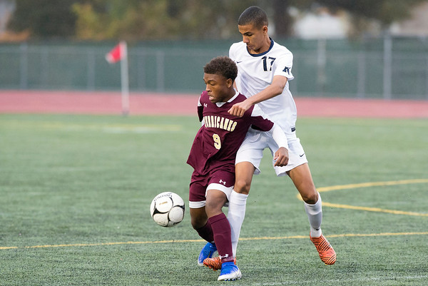 10/29/19 Wesley Bunnell | StaffrrNew Britain soccer was defeated 2-0 by Newington during a drizzle at Veterans Stadium on Tuesday afternoon. New Britain's Shevon Traille (9) and Newington's Youseff Khadrani (17).
