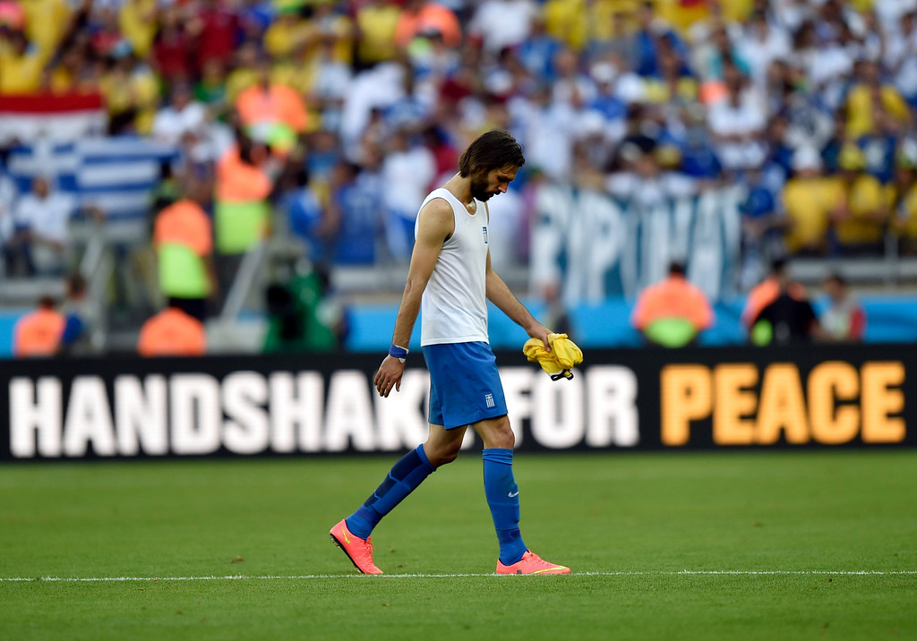 . Greece\'s Giorgos Samaras walks off the field after his team\'s 3-0 loss to Colombia during the group C World Cup soccer match between Colombia and Greece at the Mineirao Stadium in Belo Horizonte, Brazil, Saturday, June 14, 2014.  (AP Photo/Martin Meissner)