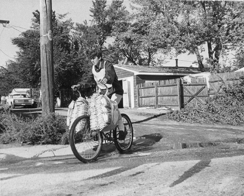. Wearing an orange safety vest over his jacket, Challis departs from his district station to start delivering newspapers on his daily route. October 1969.  (Photo by Ira Gay Sealy/The Denver Post Archive)