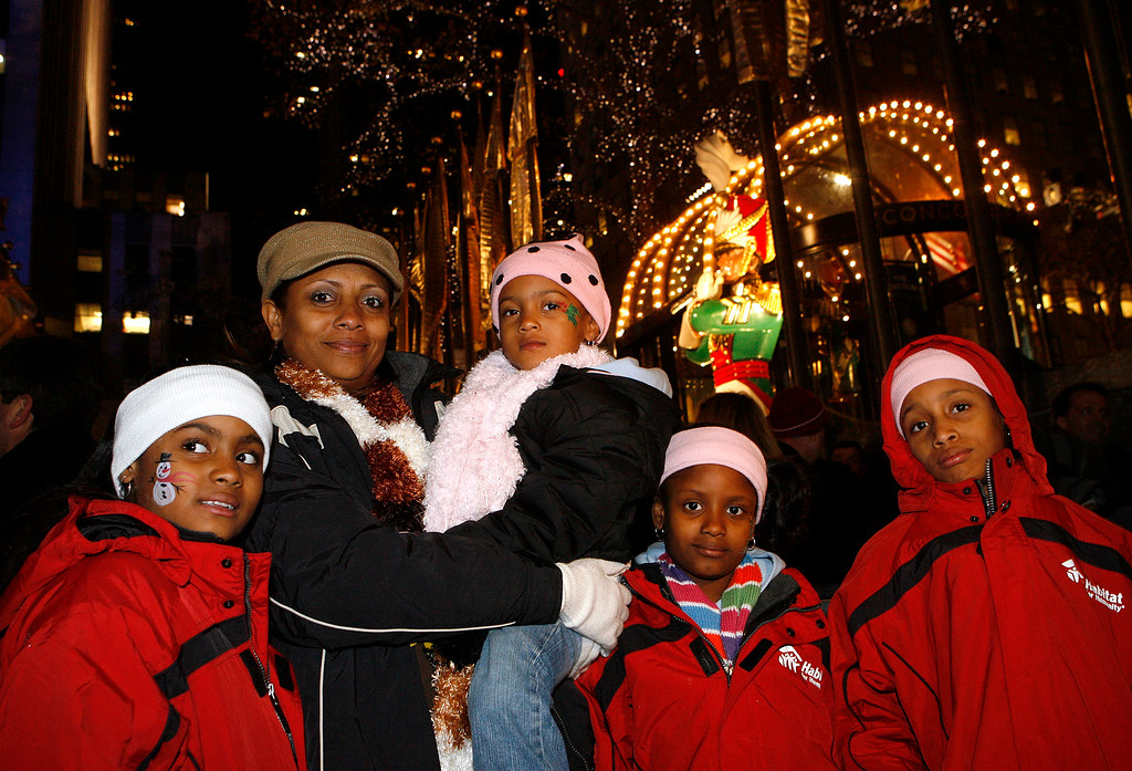 . The Davison family, from left, Nylah, 8, mother Tracey, Karly, 4, Majsa, 7, and Ashunti, 10, pose during the 76th annual Rockefeller Center Christmas tree lighting ceremony Wednesday, Dec. 3, 2008, in New York. A family of Hurricane Katrina survivors whose new house was partly built with lumber from last year\'s Rockefeller Center Christmas tree were among thousands who attended this year\'s lighting ceremony Wednesday.  (AP Photo/Jason DeCrow)