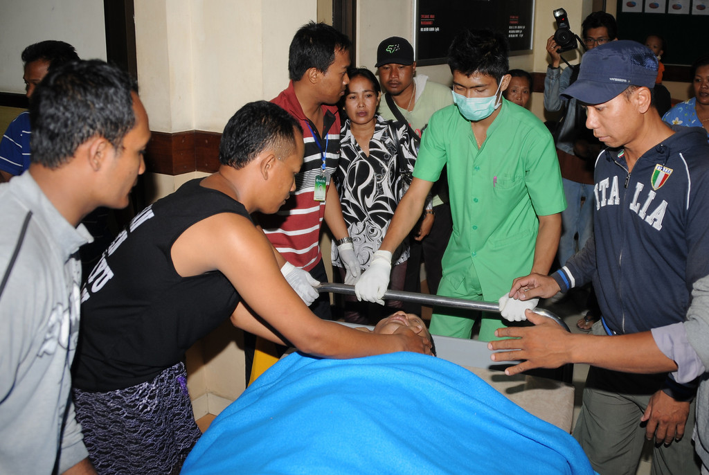 . An injured passenger (C) from the Lion Air plane that missed the runway at Bali\'s international airport is attended to at hospital as people arrive for treatment in Kedongan near Denpasar on Bali island on April 13, 2013. A Boeing passenger jet operated by budget airline Lion Air -- which recently sealed blockbuster orders for new planes -- missed the runway at Bali airport and landed in the sea but everybody on board survived. SONNY TUMBELAKA/AFP/Getty Images
