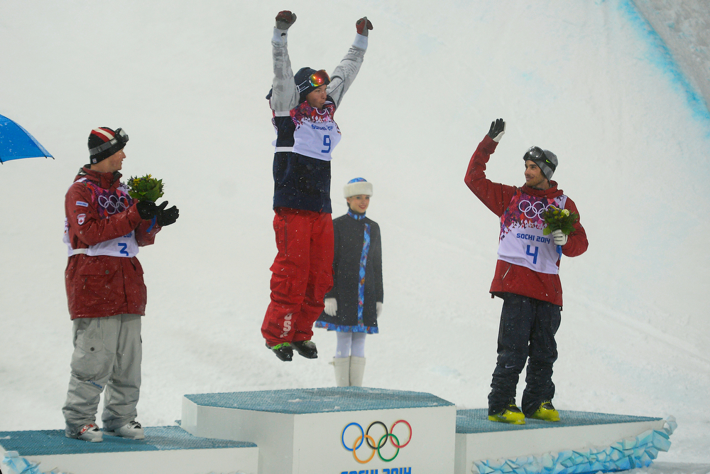 . Gold medalist David Wise (center) of the United States jumps on the podium as bronze medalists Kevin Rolland (right) of France and silver medalist Mike Riddle of Canada look on during the men\'s ski halfpipe final. Sochi 2014 Winter Olympics on Tuesday, February 18, 2014. (Photo by AAron Ontiveroz/The Denver Post)