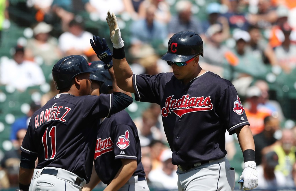 . Cleveland Indians\' Michael Brantley, right, is greeted by Jose Ramirez after hitting a solo home run during the fifth inning of a baseball game against the Detroit Tigers, Wednesday, May 16, 2018, in Detroit. (AP Photo/Carlos Osorio)