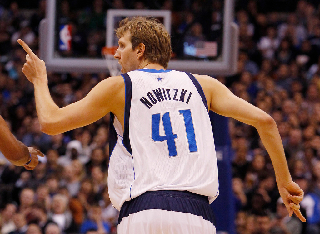 . The Dallas Mavericks\' Dirk Nowitzki (41) gestures after sinking a shot against the Denver Nuggets at the American Airlines Center in Dallas, Texas, on Friday, December 28, 2012. (Richard W. Rodriguez/Fort Worth Star-Telegram/MCT)