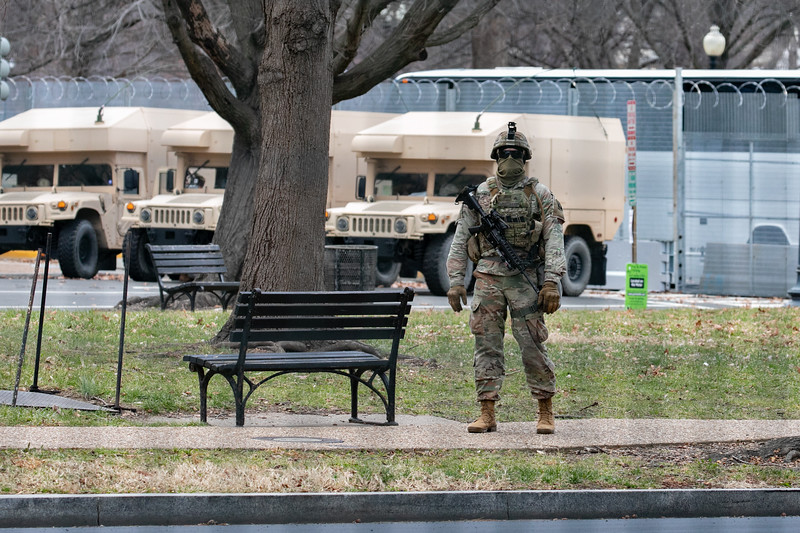 A National Guard member patrols near the U.S. Capitol as the inauguration begins