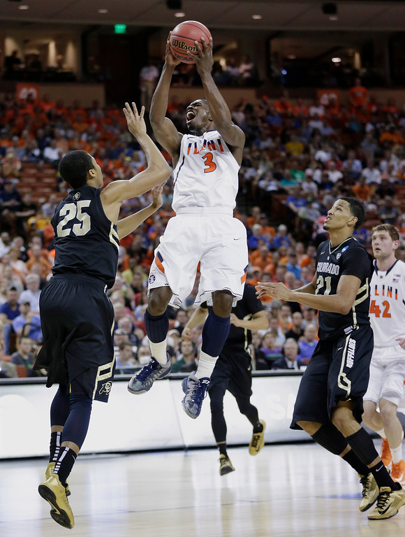 . Illinois\' Brandon Paul (3) shoots over Colorado\'s Spencer Dinwiddie (25) during the first half of a second-round game of the NCAA college basketball tournament Friday, March 22, 2013, in Austin, Texas.  (AP Photo/Eric Gay)