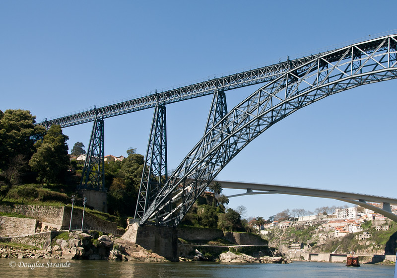 Sat 3/19 On the Douro River:  The Maria Pia bridge, designed by Eiffel in the foreground and the Infante Bridge in the distance.