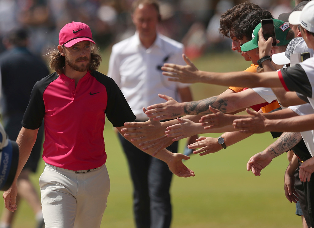 . Tommy Fleetwood of England greets fans as her walks to the 2nd tee box during the final round of the British Open Golf Championship in Carnoustie, Scotland, Sunday July 22, 2018. (AP Photo/Jon Super)