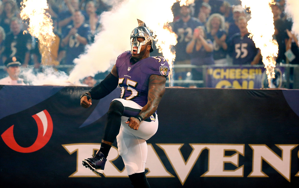 . Baltimore Ravens outside linebacker Terrell Suggs (55) wears a gladiator-style helmet as he is introduced before the Ravens\' NFL football game against the Pittsburgh Steelers on Thursday, Sept. 11, 2014, in Baltimore. (AP Photo/Alex Brandon)