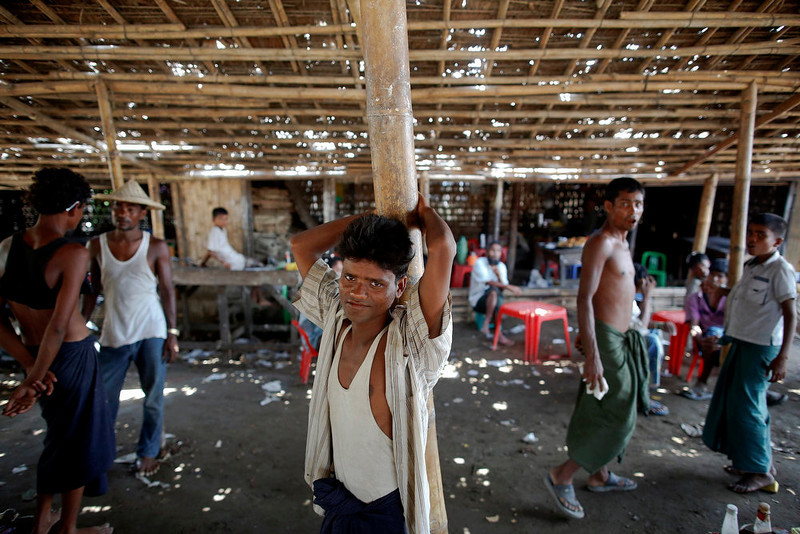 . Rohingya Muslim men wait for an auction to start at a fish market near Sittwe April 29, 2013. Myanmar must urgently address the plight of Muslims displaced by sectarian bloodshed in western Rakhine State and double the number of security forces to control the still-volatile region, an independent commission said on Monday. Its long-awaited report recommended a mixed bag of humanitarian and security responses to violence last June and October that killed at least 192 people and left 140,000 homeless, mostly stateless Rohingya Muslims in an area dominated by ethnic Rakhine Buddhists.   REUTERS/Damir Sagolj