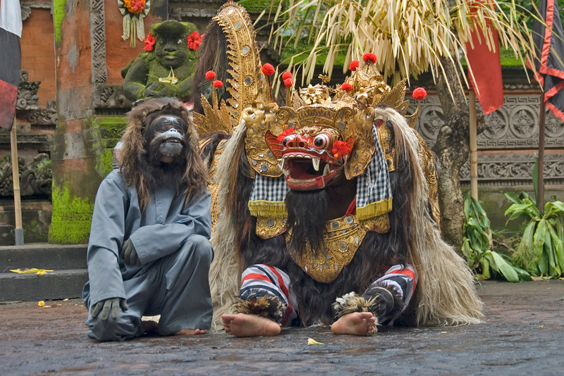 Barong and Monkey mascot during performance in Bali, Indonesia