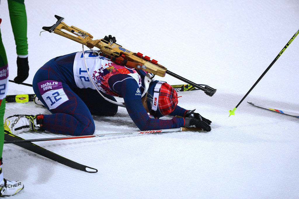 . Norway\'s Tiril Eckhoff kneels on the snow as she snatches bronze in the Women\'s Biathlon 12,5 km Mass Start at the Laura Cross-Country Ski and Biathlon Center during the Sochi Winter Olympics on February 17, 2014, in Rosa Kuthor, near Sochi. AFP PHOTO / KIRILL  KUDRYAVTSEV/AFP/Getty Images