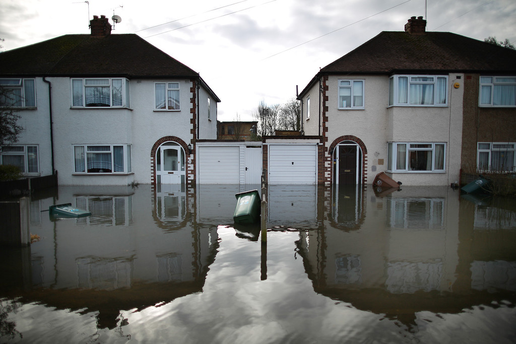 . Flood water surrounds housing on February 13, 2014 in Staines-Upon-Thames, England. Flood water has remained high in some areas and high winds are causing disruption to other parts of the UK with the Met Office issuing a red weather warning.  (Photo by Peter Macdiarmid/Getty Images)