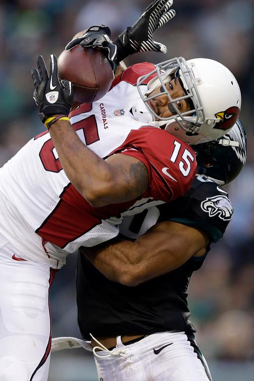. Arizona Cardinals\' Michael Floyd pulls in a pass against Philadelphia Eagles\' Nate Allen during the second half of an NFL football game, Sunday, Dec. 1, 2013, in Philadelphia. (AP Photo/Matt Rourke)