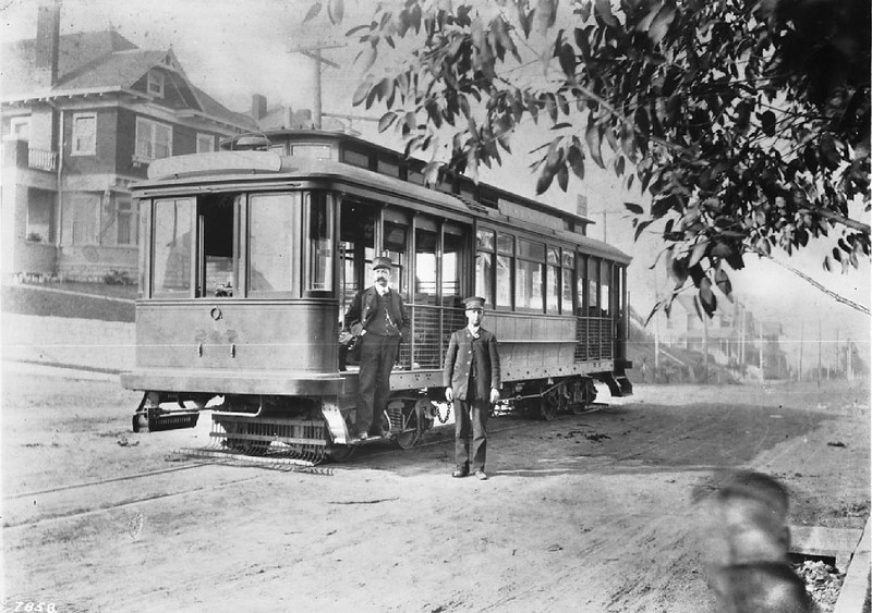 Portrait of two streetcar conductors with their streetcar on Ninth and Grand View Avenue, Los Angeles, ca.1900