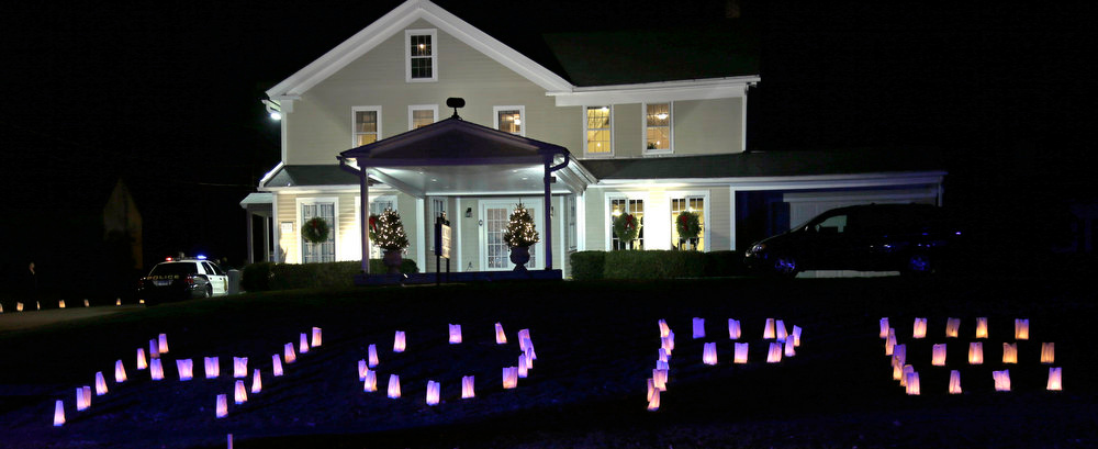 ". The word ""HOPE\"" is illuminated on the front lawn of a funeral home hosting the wake of Sandy Hook Elementary School principal Dawn Lafferty Hochsprung in Woodbury, Conn., Wednesday, Dec. 19, 2012. A gunman opened fire killing 26 people, including the principal and 20 children, at the school in Newtown before killing himself on Dec. 14. (AP Photo/Charles Krupa)"