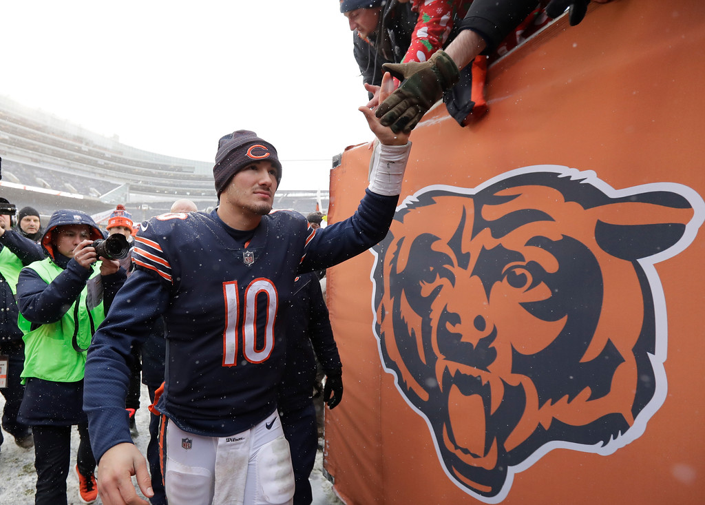 . Chicago Bears quarterback Mitchell Trubisky (10) shakes hands with fans after beating the Cleveland Browns 20-3 in an NFL football game in Chicago, Sunday, Dec. 24, 2017. (AP Photo/Charles Rex Arbogast)
