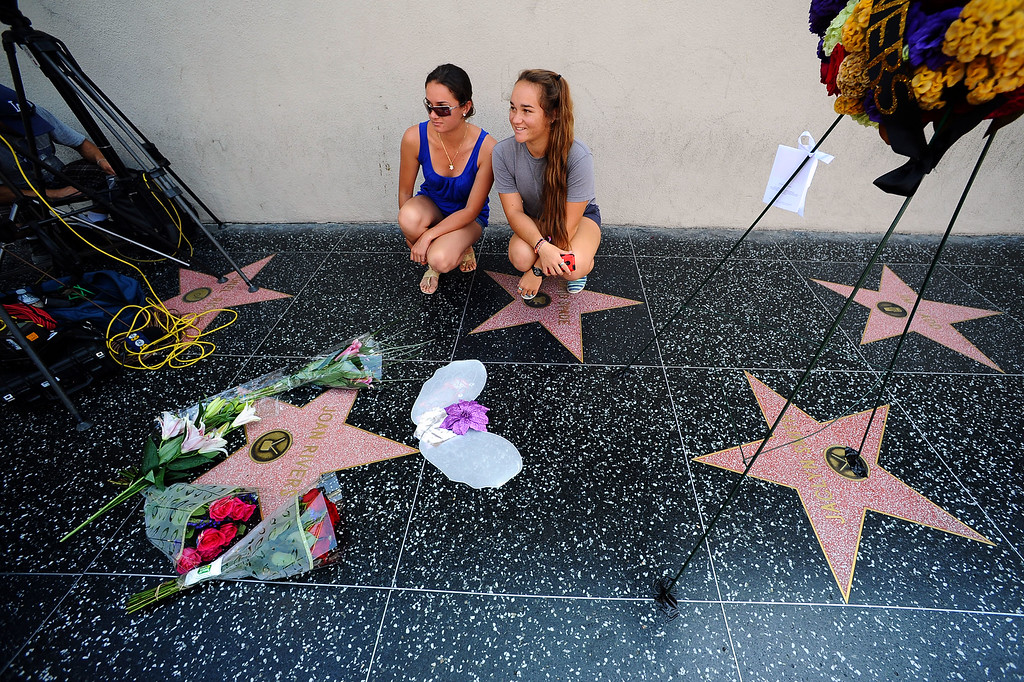 . Sisters Keely and Leimana Hassett pose for a photo at Joan Rivers star on the Hollywood Walk of Fame after her passing Thursday, September 4, 2014.(Andy Holzman/Los Angeles Daily News)
