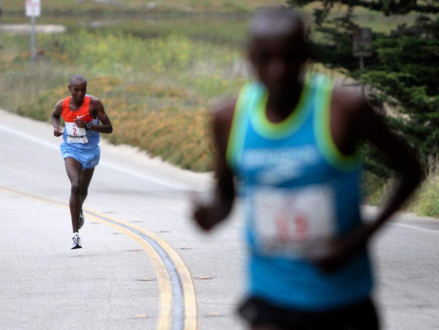 . Wharf to Wharf second place winner Shadrack Kosgei trails behind first place winner Nelson Oyugi during the annual race on Sunday. (Kevin Johnson/Sentinel)
