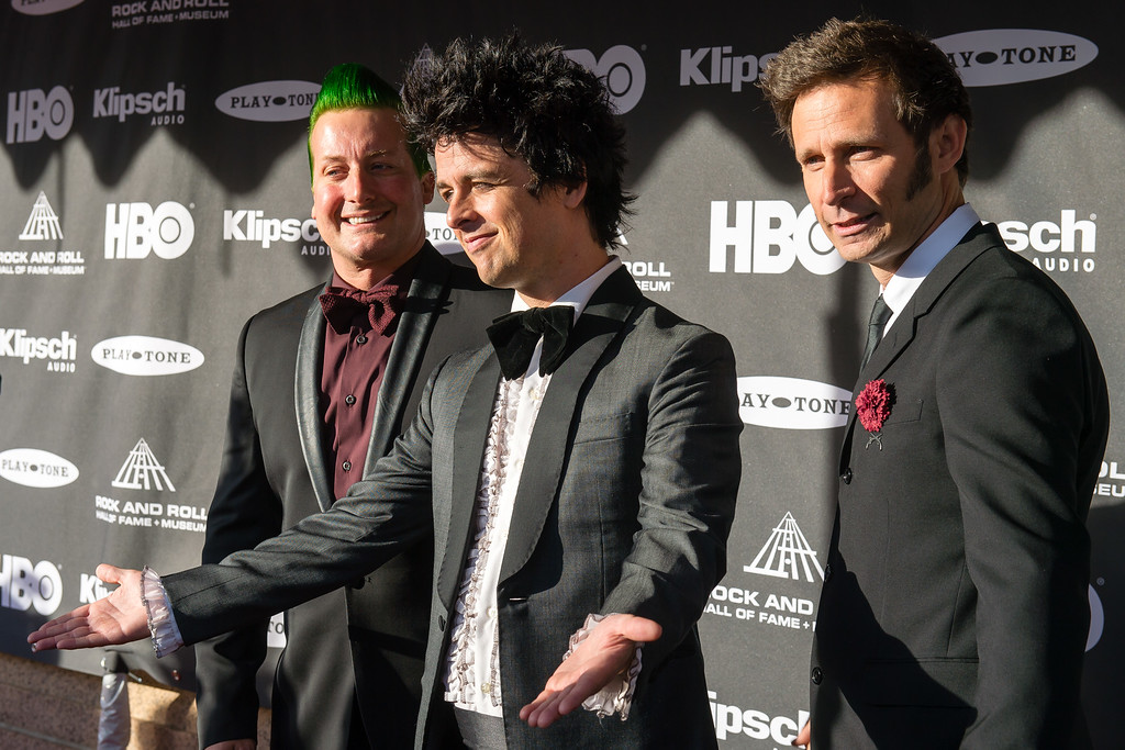 . The members of the band Green Day prior to the 2015 Rock And Roll Hall Of Fame Induction Ceremony at Public Hall on Saturday, April 18, 2015, in Cleveland, Ohio. (Photo by Jason Miller/Invision/AP)