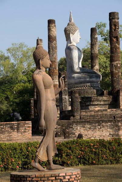 Buddha statues among ruins in Wat Sa Si - Sukhothai, Thailand