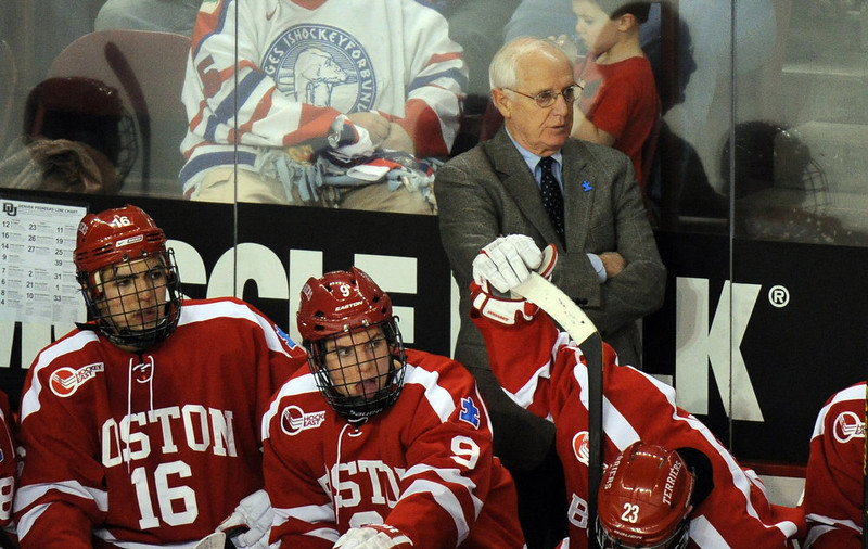 . Boston University  head coach Jack Parker, top, is in the bench during the game against the University of Denver at Magness Arena in Denver, Colo. on Saturday, December 29, 2012. Hyoung Chang, The Denver Post