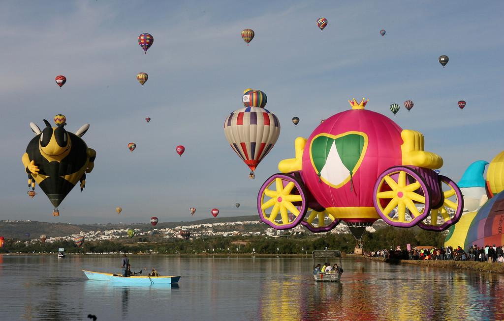 . Balloons take off over the Palote dam during the Hot Air Balloon Festival in Leon, Mexico, Friday, Nov. 15, 2013.  (AP Photo/Mario Armas)