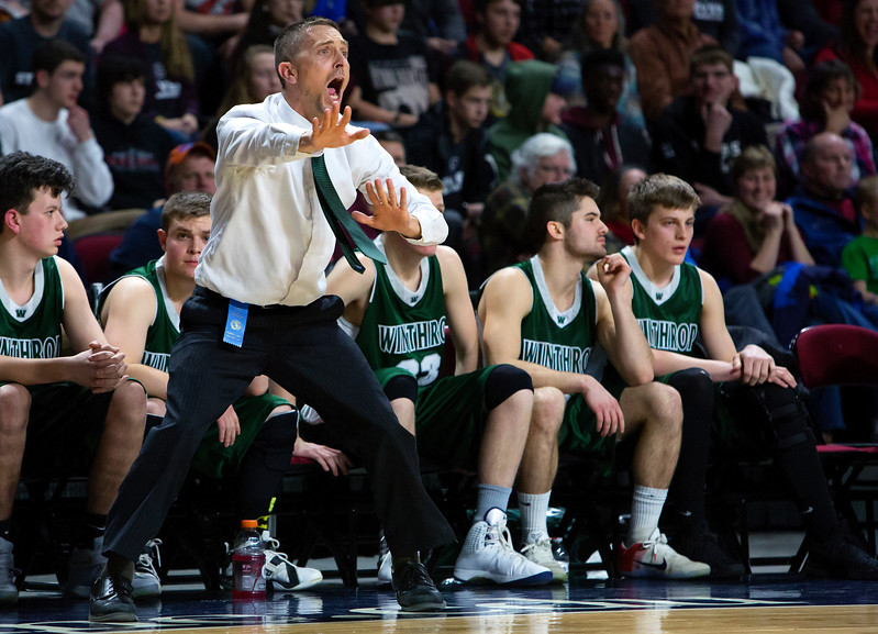 BANGOR, Maine -- 03/04/2017 -- Winthrop head coach Todd MacArthur yells instructions to his team during their Class C boys basketball state championship against George Stevens Academy at the Cross Insurance Center in Bangor Saturday. Ashley L. Conti | BDN