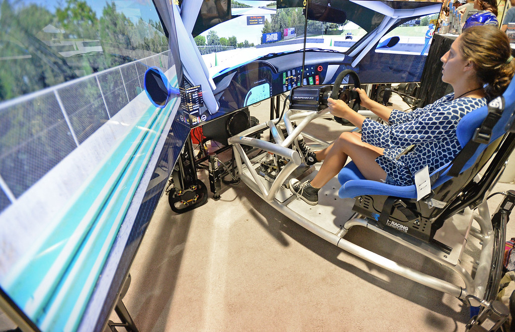 . People try their hand at race car driving simulators in the Lifestyle Expo of the Toyota Grand Prix of Long Beach Friday, April 17, 2015, Long Beach, CA.   Photo by Steve McCrank/Staff Photographer