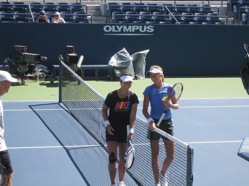 Li Na and Daniela Hantuchova after practice