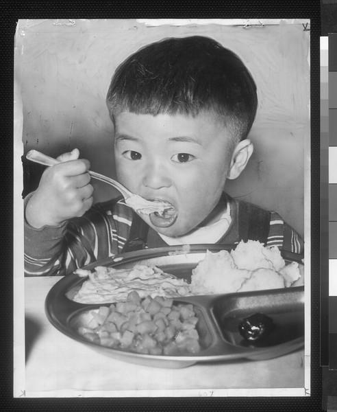 """""""Little Boy, Big Appetite"""" -- caption on photograph"""