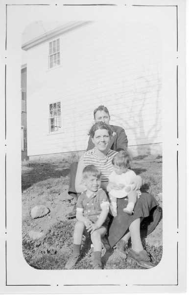 Dr. (James)  and Mrs. (Charlotte) Lacey and children Joan and John outside addition to Family home in Southbridge MA.
