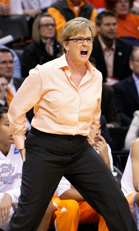. Tennessee coach Holly Warlick yells to her team as it plays Louisville during the first half of the Oklahoma City regional final in the NCAA women\'s college basketball tournament in Oklahoma City, Tuesday, April 2, 2013. (AP Photo/Alonzo Adams)
