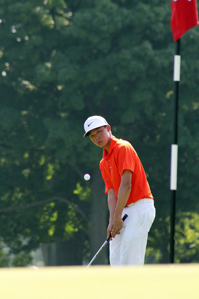 Lorens Chan of Honolulu, Hawaii eyes a chip as it approaches the green on his back nine during his opening match at the 2012 Western Amateur Championship at Exmoor Country Club in Highland Park, IL on Friday, Aug. 3, 2012. (WGA Photo/Ian Yelton)
