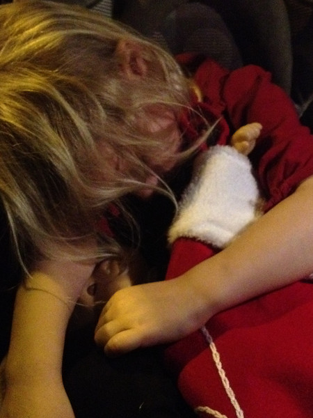 Fast asleep on the way home holding her Christmas stocking I had just made for her.