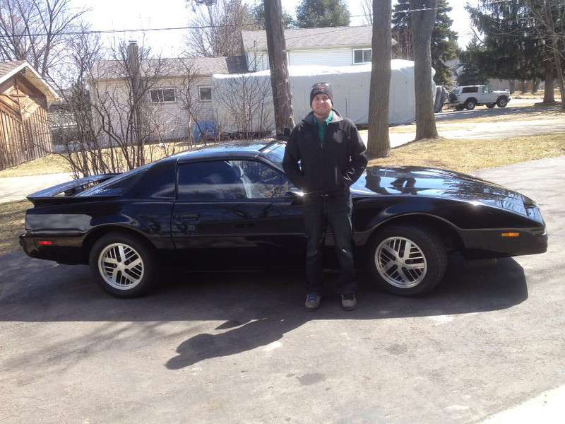 """. Photo: jills_firehawk; ethan_and_jons_firebird Name: Cutline: This is my 2000 formula firehawk and my 1987 formula firebird. These cars were both owned by my brothers. I bought the firehawk from my brother who wanted to buy a corvette a few years ago. My brother Jon passed away in 2012 and I inherited the 1987. Jon loved the woodward dream cruise and came up from Illinois every year to participate. unfortunatly he never drove the car at woodward so my husband and I drove it up and down woodward in his memory. we also left 2 black marks that shouted out \""""Jon was here!\"""""""