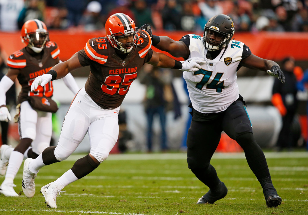 . Cleveland Browns defensive end Myles Garrett (95) runs a route past Jacksonville Jaguars offensive tackle Cam Robinson (74) in the first half during an NFL football game, Sunday, Nov. 19, 2017, in Cleveland. (AP Photo/Ron Schwane)