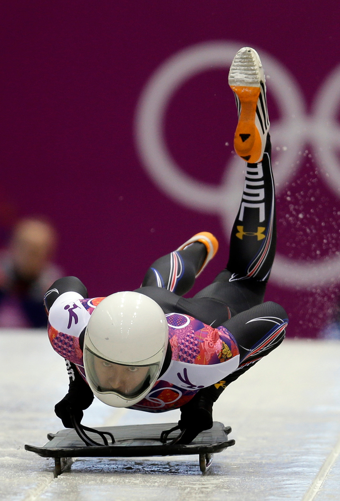 . Kyle Tress of the United States starts his first run during the men\'s skeleton competition at the 2014 Winter Olympics, Friday, Feb. 14, 2014, in Krasnaya Polyana, Russia. (AP Photo/Natacha Pisarenko)