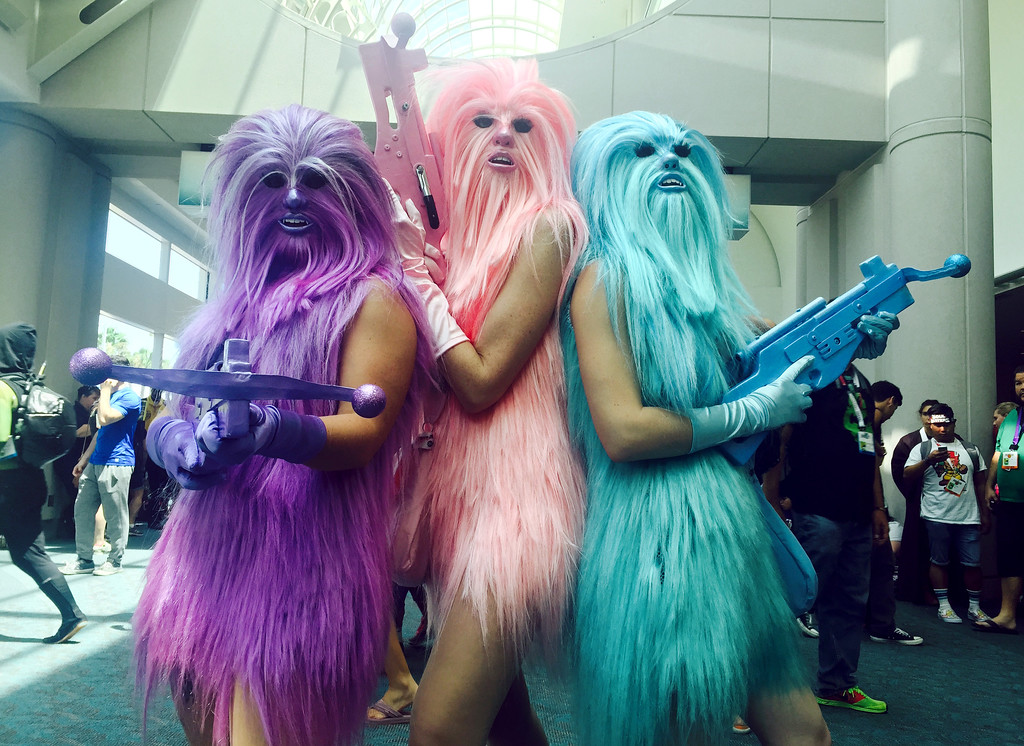 ". FILE - In this July 10, 2015 file photo, fans dressed as ""Chewie\'s Angels\"" attend day 2 of Comic-Con International, in San Diego, Calif.  Star Wars� inspires curiously personal reactions. It drives some people to don Wookie costumes and others to curse an entire industry as infantile. Since the 1977 debut of �A New Hope,� it�s become a generational rite of passage not just to experience the saga, but to form one�s relationship with movies around it, whether in happy lockstep or rebel opposition.  (Photo by Chelsea Vicari/Invision/AP, File)"